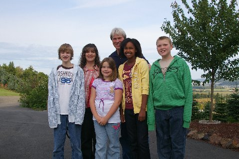 John and Cheryl Burton and children ready for school: Jonathan, Emily, Keisha, and Donovan